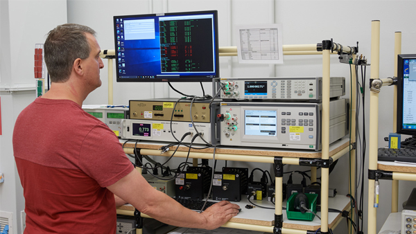 Technician Using a Fluke 8588A in a Calibration Lab